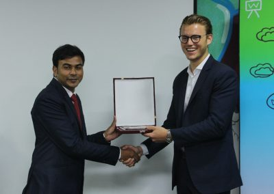 The Country Director of YSI Bangladesh Mr. Suman Saha is handing over the token of thankfulness to the CEO of YSI Global Mr. Marcus Bruns